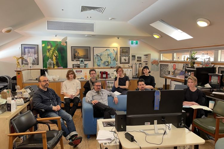 Image of SymbioticA staff and residents watching a talk by Paul Vanouse